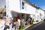 Typical street scene ladies clothes fashion shop and gifts on sale on holiday island of Ile de Re, France