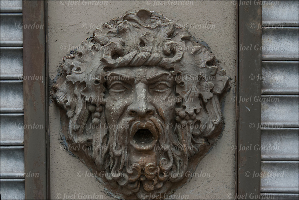 Architectural decorative use of iron or metal 19th century face, design and ornamental use on building in New York City.