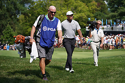 August 10, 2018 - St. Louis, Missouri, United States - Tiger Woods (C) and his caddie Joe LaCava (L) walk off the 9th green during the second round of the 100th PGA Championship at Bellerive Country Club. (Credit Image: © Debby Wong via ZUMA Wire)