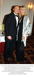 TV presenter GABBY ROSLIN and her husband MR COLIN PEEL at a ball in London on 11th March 2004.PSH 79