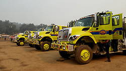 July 30, 2018 - California, U.S. - Fire Trucks and water hose vehicles parked. The Ferguson Fire now in its 20th day, started July 13 on the Sierra National Forest. The fire is now 62,883 acres with 39 percent containment and 3,558 personnel that are currently engaged on the fire which include 203 engines, 43 water tenders, 14 helicopters, 95 crews, 5 masticators and 62 dozers. There has been 2 fatalities and 9 injuries to date. 1 structure has been destroyed. (Credit Image: © Rubicon/Cal Fire via ZUMA Wire/ZUMAPRESS.com) (Credit Image: © Rubicon/Cal Fire via ZUMA Wire/ZUMAPRESS.com)