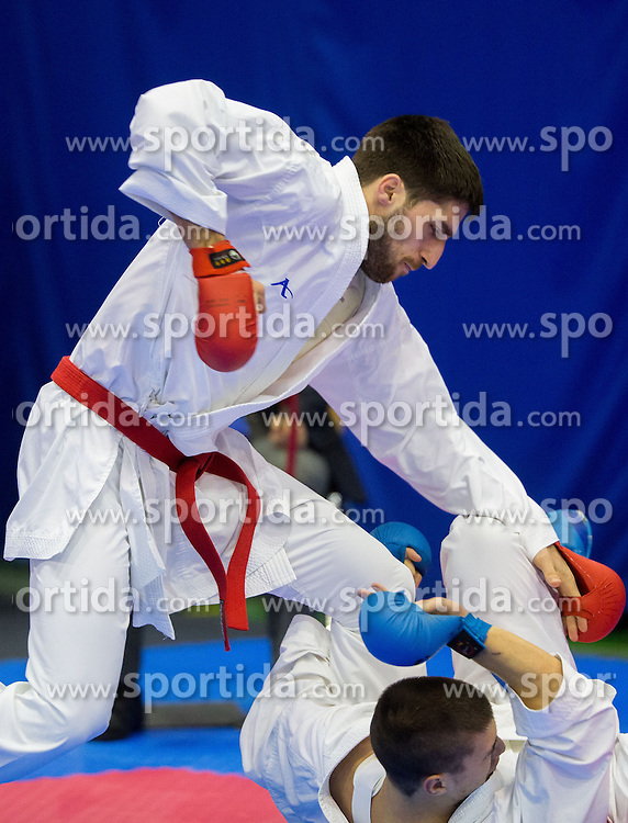 Stefan Petkov of Bulgaria (blue) fighting against Milos Jovanovic of Serbia (red) during Kumite Individual male Seniors -84 kg at Day One of Karate 1 World Cup - Thermana Slovenia Lasko 2014 tournament, on March 15, 2014 in Arena Tri Lilije, Lasko, Slovenia.Photo by Vid Ponikvar / Sportida