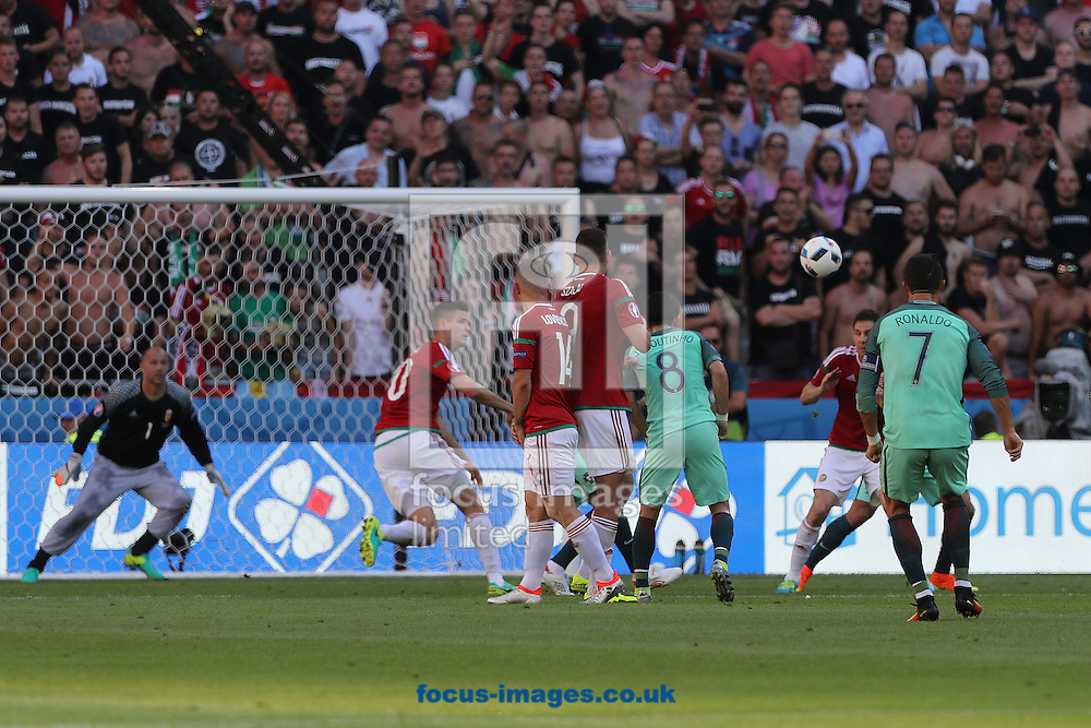 Cristiano Ronaldo of Portugal has a shot on goal from a free kick during the UEFA Euro 2016 match at Stade de Lyons, Lyons<br /> Picture by Paul Chesterton/Focus Images Ltd +44 7904 640267<br /> 22/06/2016