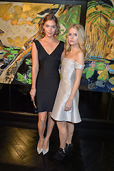 Left to right, ARIZONA MUSE and LOTTIE MOSS at a party to celebrate the launch of the Maddox Gallery at 9 Maddox Street, London on 3rd December 2015.