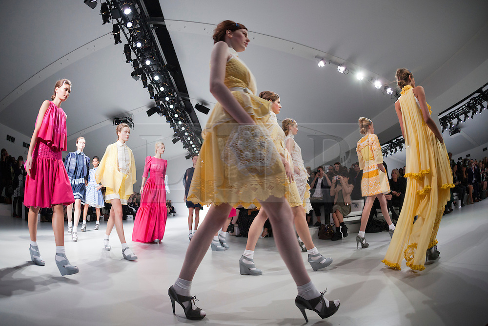 © Licensed to London News Pictures. 13/09/2013. London, England. Models walk down the catwalk during the finale of the Bora Aksu fashion show during London Fashion Week at Somerset House. Photo credit: Bettina Strenske/LNP