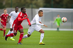 NEWPORT, WALES - Thursday, September 25, 2014: Wales' Ibi Sosani in action against France's Enzo Ebosse during the Under-16's International Friendly match at Dragon Park. (Pic by David Rawcliffe/Propaganda)