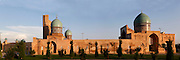 """Panoramic view of the Barak-Khan Madrasah, 16th-17th century, Tashkent, Uzbekistan, seen on July 4, 2010, in the late afternoon summer light. Tashkent, 2000 year old capital city of Uzbekistan, a Silk Road city whose name means """"Stone Fortress"""", is now very modern due to a disastrous earthquake in 1966, after which it was greatly rebuilt. However, some of the old buildings still stand in the glittering modern city."""