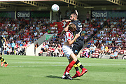 Will Boyle and Ollie Palmer during the EFL Sky Bet League 2 match between Cheltenham Town and Crawley Town at LCI Rail Stadium, Cheltenham, England on 4 August 2018. Picture by Antony Thompson.
