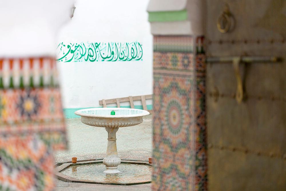 MARRAKESH, MOROCCO - 19TH APRIL 2016 - Water fountain inside the Zaouia / zawiya burial tomb shrine site of Sidi Abdullah al-Ghazwani, Marrakesh, Morocco.