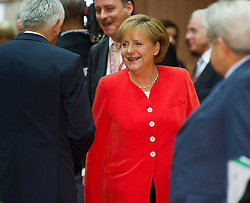 Angela Merkel, Germany's chancellor, center, arrives for the European Summit meeting at EU Council headquarters in Brussels, Belgium, on Thursday, June 17, 2010. (Photo © Jock Fistick)