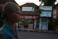 Elderly lady passes by a 24/7 store - Bali revisited February 2017