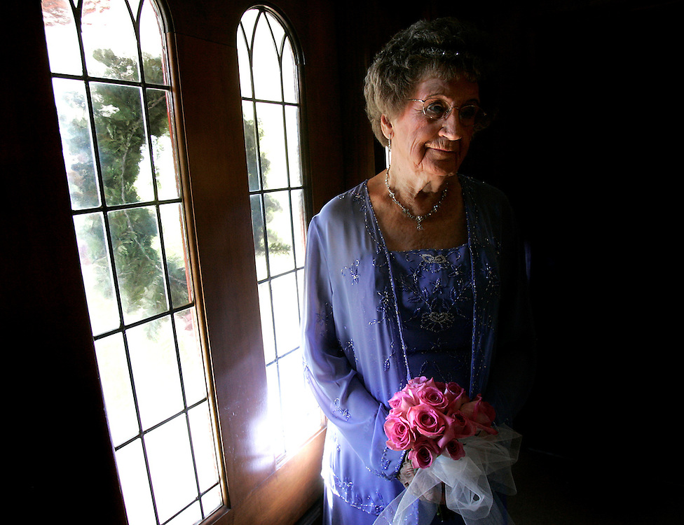 McAllen, TX / 2006 - Esther Reinholdt, of Iowa, waits near the front door of the Tip o' Texas RV Park chapel Friday afternoon to be married to long-time friend Orville Eikenhorst, of Nebraska.  Both are 83 years old and each recently lost spouses to Alzheimer's disease. Photo by Mike Roy / The Monitor