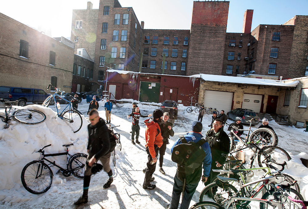 Participants wait to be told where Stupor Bowl 17 will begin in the alley behind One on One Bicycle Studio in Minneapolis February 1, 2014. (Courtney Perry for MPR)