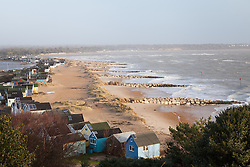 © Licensed to London News Pictures. 06/01/2014. Mudeford Spit, Christchurch, Dorset, UK. Rough seas at Mudeford Spit near Christchurch in Dorset, UK. The beach huts sell for an average of around £140,000. Dorset is expected to be one of the worst affect areas, with more heavy rain and flooding forecast. Photo credit : Rob Arnold/LNP