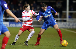 Andrew Hughes of Peterborough United in action with Alfie May of Doncaster Rovers - Mandatory by-line: Joe Dent/JMP - 01/01/2018 - FOOTBALL - ABAX Stadium - Peterborough, England - Peterborough United v Doncaster Rovers - Sky Bet League One