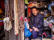 05 MARCH 2017 - KATHMANDU, NEPAL: A shop keeper sells Buddhist supplies at Seto Machindranath Temple, a 12th century Buddhist temple in Kathmandu.     PHOTO BY JACK KURTZ