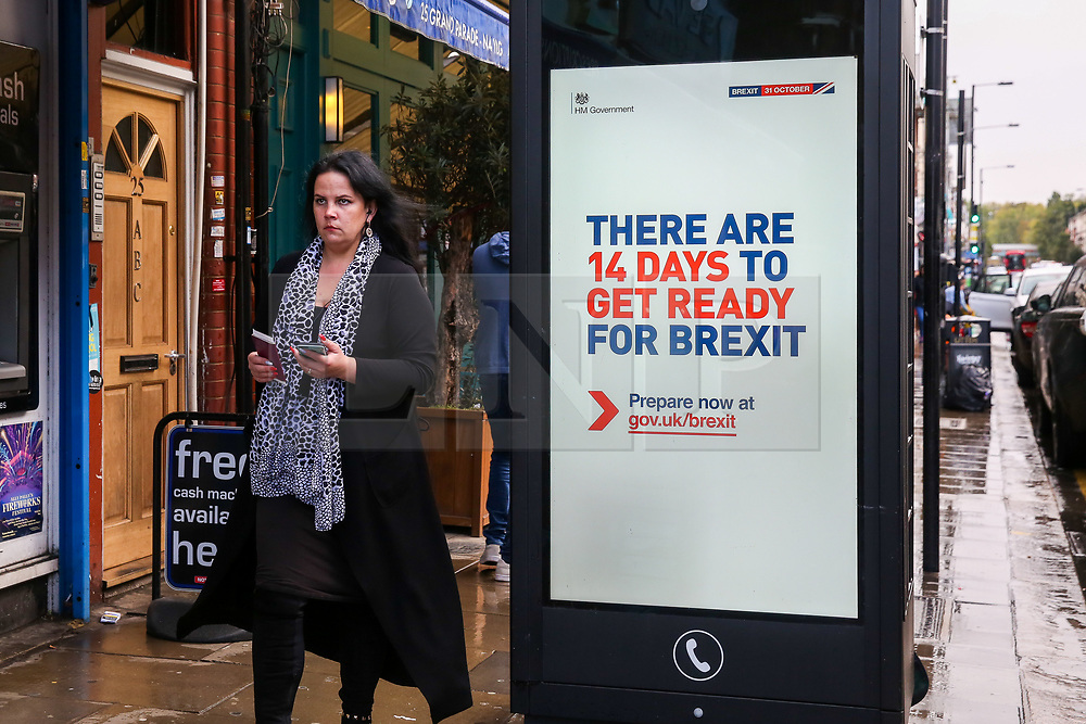© Licensed to London News Pictures. 17/10/2019. London, UK. A member of the public walks past the latest Brexit advert in Haringey, north London, with fourteen days to Brexit day. The Get ready for Brexit campaign is costing £100m, preparing the nation to depart the EU. A Brexit deal has been agreed between the UK and EU before a meeting of European leaders in Brussels and the UK will leave EU on 31 October if MPs back Brexit deal on Saturday 19 October 2019. Photo credit: Dinendra Haria/LNP