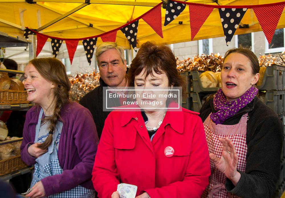 Pictured: Iain Gray and Sarah Boyack helped out at the Allgoument Bread stall sandwiched between Alice Crighton and owner Sara Roseburgh.<br /> <br /> The former Scottish Labour leader Iain Gray joined colleague Sarah Boyack activists and supporters at a street stall at Stockbridge Market. <br /> Ger Harley | EEm 10 April 2016