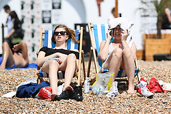 © Licensed to London News Pictures. 18/06/2015. Brighton, UK. Sunny and warm weather whit hundreds of people relaxing and sunbathing on Brighton Beach, today June 18th 2015. Photo credit : Hugo Michiels/LNP