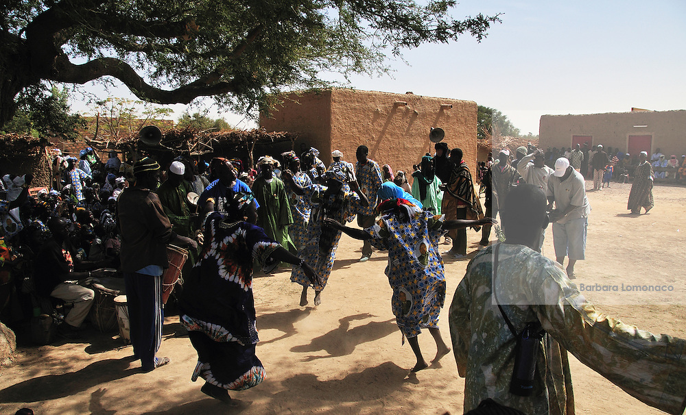 Women dancing at the drummers rhythms during the festival