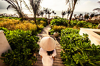 A young Vietnamese woman at one of the villa suites at the Six Senses Con Dao resort.