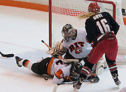 2012/03/04 - RIT's Ariane Yokoyama helps goalie Laura Chamberlain block a shot in the second period of the ECAC West Championship game between RIT and SUNY Plattsburgh at RIT's Ritter Arena on March 4th, 2012. RIT lead 2-1 after two periods of play.