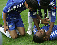 Photo: Lee Earle.<br /> Chelsea v Manchester United. The FA Cup Final. 19/05/2007.Chelsea's Didier Drogba is congratulated after scoring the winning goal.