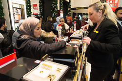 © Licensed to London News Pictures. 26/12/2016. Customers in the perfume department of Selfridges store in Oxford Street for the start of the stores Boxing Day sales. London, UK. Photo credit: Ray Tang/LNP