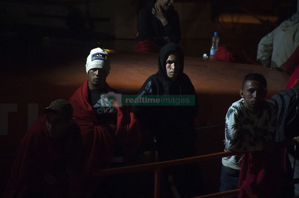 October 1, 2018 - Malaga, Spain - Moroccan and algerian migrants stand on a rescue boat after their arrival at the Port of Malaga. Spain's Maritime Rescue service rescued 96 migrants aboard dinghies at the Mediterranean Sea and brought them to Malaga Harbour, where they were assisted by the Spanish Red Cross. More than 300 migrants have been rescued by the Spain's Maritime Rescue during this day. (Credit Image: © Jesus Merida/SOPA Images via ZUMA Wire)