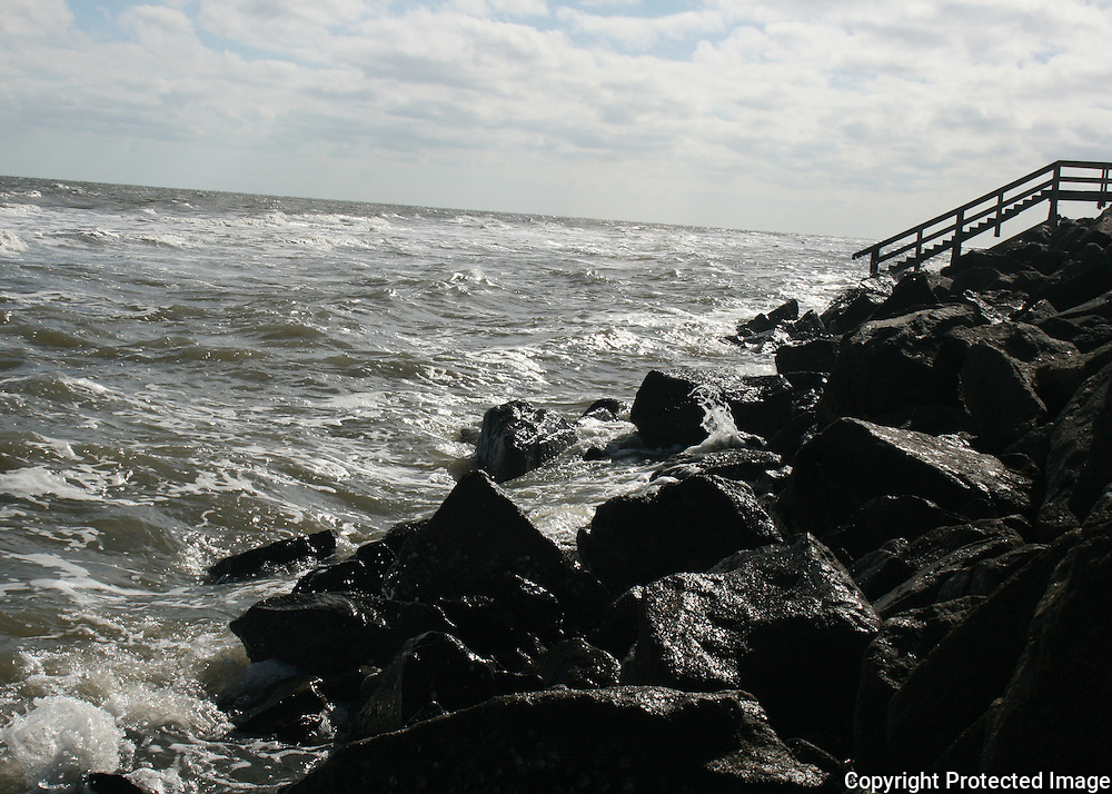 Steps descending into winter seas on Jekyll Island beach