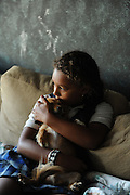 SUN-STAR PHOTO BY BEA AHBECK<br /> Jasmine Schmitz, 8, snuggles her dog Buddy in her home by the Last Hope Cat Kingdom in Atwater, Calif. Aug. 26, 2010.
