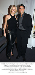 MISS CAROLINE STANBURY and her fiancé MR CEM HABIB at a party in London on 8th October 2003.PNK 261