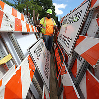 Tony Gonzales begins unloading detour and road closed signs along South Green Street and other streets around downtown Tupelo as work along the BNSF railroad is causing road closures,