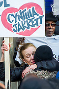 "Supporters of Mark Duggan's family hold a vigil outside Tottenham  police station. They gathered, alongside family members and his mother Pam Duggan and Aunt Carole Duggan (pictured) , at 2pm following an inquest jury ruling that Duggan was lawfully killed when police shot him dead while he was unarmed.  Within days of his shooting, in 2011, rioting broke out on the streets of London, and spread to other urban areas in England.  Pastor Nims Obunge, who oversaw Duggan's funeral in 2011, said: ""The message from the family is that this vigil is intended to be a very peaceful vigil"". Tottenham, London, UK 11 January 2014. Guy Bell, 07771 786236, guy@gbphotos.com"