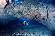 diver explores underwater arch in series of lava tubes,, The Caverns, aka Sheraton Caverns, Poipu, Kauai, Hawaii, USA ( Pacific ) MR 290