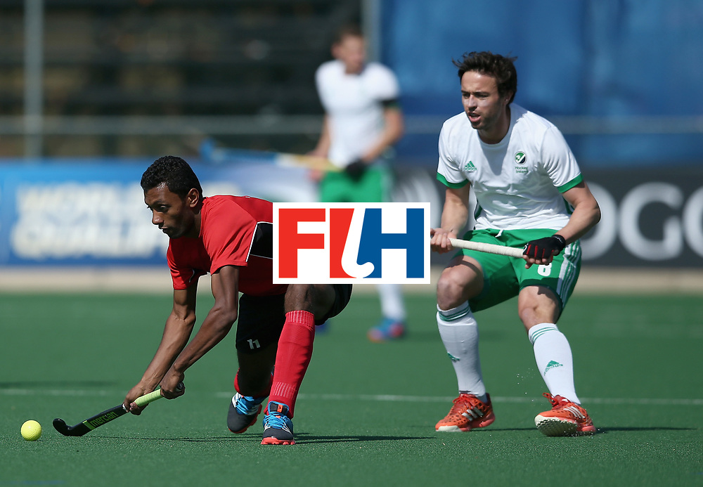 JOHANNESBURG, SOUTH AFRICA - JULY 13: Ahmed Elnaggar of Egypt controls the ball under pressure from Chris Cargo of Ireland during day 3 of the FIH Hockey World League Semi Finals Pool B match between Ireland and Egypt at Wits University on July 13, 2017 in Johannesburg, South Africa. (Photo by Jan Kruger/Getty Images for FIH)