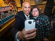 01 JANUARY 2020 - CRESTON, IOWA: US Senator CORY BOOKER (D-NJ) takes a selfie with a woman during a campaign event at Adams Street Espresso in Creston, IA. Sen. Booker is campaigning in Iowa to support his candidacy for the US Presidency. Iowa traditionally holds the first event of the presidential election cycle. The Iowa caucuses are Feb. 3, 2020.     PHOTO BY JACK KURTZ