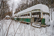 Trolley Graveyard<br /><br />Located out in the wilderness of Pennsylvania lies a set of street cars, most of which are from Boston and Philadelphia. Often mistaken as being abandoned, the graveyard is actually a scrapyard and an active business.<br /><br />They are owned by a man named Ed Metka who purchased many of them in the 1980s, when rail services were auctioning off their out of service PCC fleet. He had them transported on flatbeds from Boston to his railcar repair shop in a small coal mining town in the mountains of Pennsylvania.<br /><br />The name PCC comes from the name of a design committee formed in 1929 as the Presidents&rsquo; Conference Committee. The PCC streetcar design was first built in the United States in the 1930s. The design proved successful here, and after World War II it was licensed for use elsewhere in the world. They were manufactured by St. Louis Car Company and Pullman Standard, many of which are still in service all around the world.<br /><br />Metka had initially planned to repair them and sell them , but hasn&rsquo;t found an interested buyer for them yet. Over the past couple of years, the cars have been vandalized and scrap metal thieves have stolen parts of the cars. Until a buyer is found, they will continue to deteriorate.<br />&copy;Abandoned Florida/Exclusivepix Media
