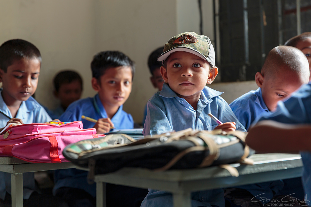 Boys studying in a primary school class