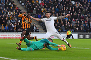 Hull City goalkeeper Allan McGregor (1) makes save against Derby County midfielder Bradley Johnson (15)  during the EFL Sky Bet Championship match between Hull City and Derby County at the KCOM Stadium, Kingston upon Hull, England on 26 December 2017. Photo by Ian Lyall.