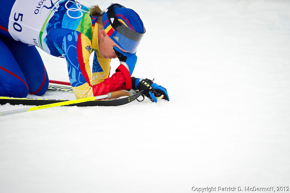 Monika Gyorgy of Romania collapses after the ladies' 30 km mass start cross-country skiing classic on day 16 of the 2010 Vancouver Winter Olympics at Whistler Olympic Park Cross-Country Stadium on February 27, 2010 in Whistler, Canada.