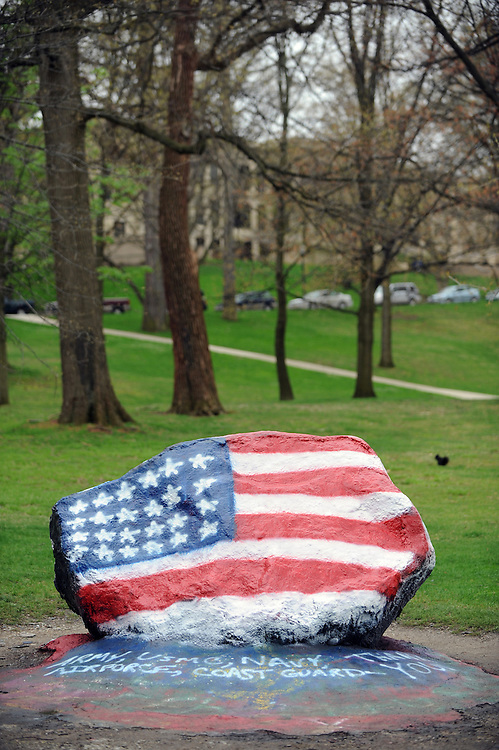 "Painting ""The Rock,"" a Kent State tradition going back almost 100 years, is a staple of student life at Kent State. Here. the rock is painted in patriotic colors."