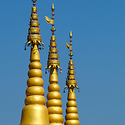 Spires on a Thai-Burmese temple at ban Tuea Leua in Tak, Thailand.