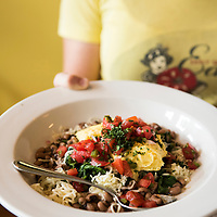 "A waitress holds a dish of the ""veggie breakfast bowl"" at the Early Girl Eatery, a self-described ""farm to table southern comfort food experience."" It is located at 8 Wall Street in Downtown Asheville, North Carolina."