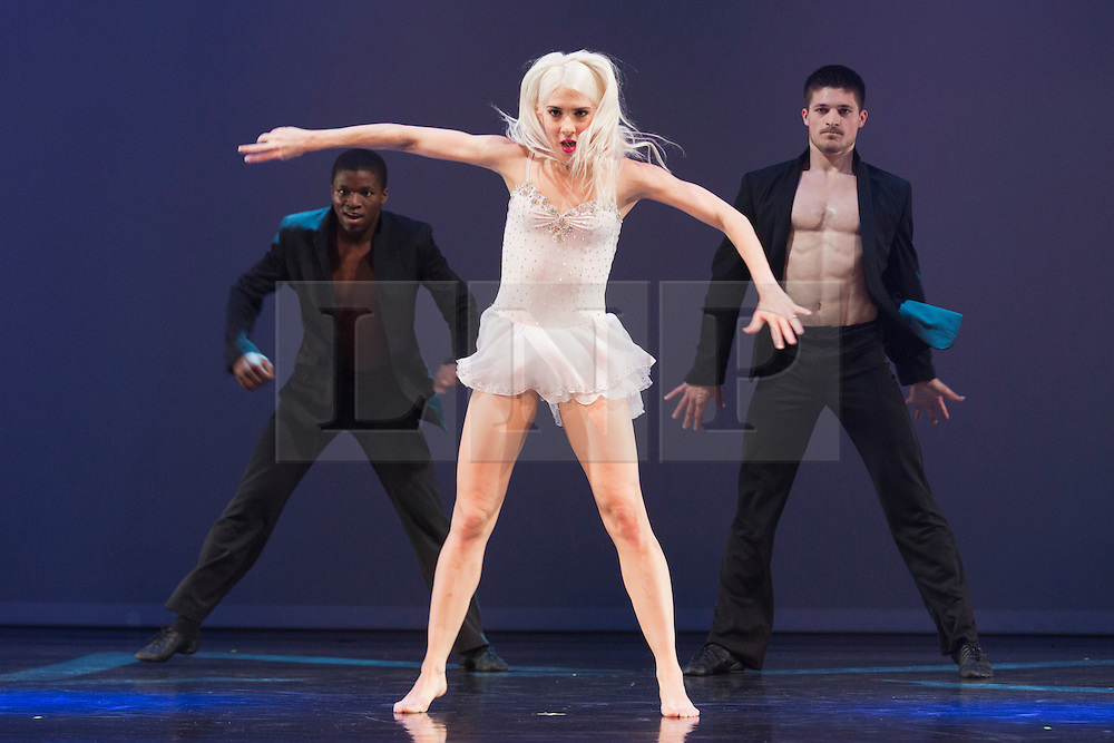 "© Licensed to London News Pictures. 12/06/2014. London, England. L-R: Joshua Alexander, Adrienne Canterna and Blake Zelesnikar. Rasta Thomas' ""Rock the Ballet"" starring the Bad Boys of Dance makes its London debut at the Peacock Theatre. ""Rock the Ballet"" is a fusion of classical ballet techniques belnded with musical theatre, hip hop and acrobatics. The show is danced to some of rock and pop's biggest hits. Choregraphed and danced by Adrienne Canterna with ""The Bad Boys of Dance"" James Boyd, Robbie Nicholson, Tim Olson, Lee Gumbs, Blake Zelesnikar and Joshua Alexander. At the Peacock Theatre from 10 to 28 June 2014. Photo credit: Bettina Strenske/LNP"