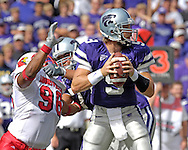 Kansas State quarterback Dylan Meier (9) looks down field against pressure form Louisville defensive end Zach Anderson (96) in the first half, at Bill Snyder Family Stadium in Manhattan, Kansas, September 23, 2006.  The 8th ranked Louisville Cardinals beat K-State 24-6.
