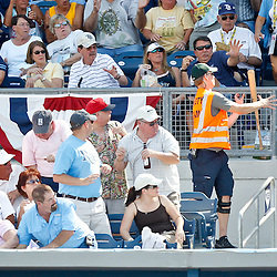 February 26, 2011; Port Charlotte, FL, USA; The bat of Tampa Bay Rays third baseman Evan Longoria (not pictured) flys into the stands where it is caught by a member of stadium security during a spring training exhibition game against the Pittsburgh Pirates at Charlotte Sports Park. The Rays defeated the Pirates 9-5.  Mandatory Credit: Derick E. Hingle