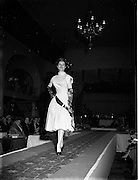 10/05/1955<br /> 05/10/1955<br /> 10 May 1955<br /> N.A.I.D.A. Annual Fashion Parade at the Gresham Hotel, Dublin. Model on the catwalk.