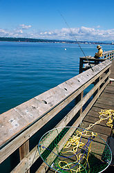 North America, USA, Washington, Tacoma. Man fishing from pier