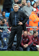An unhappy Carlo Ancelotti  looks on from the sideline during the Barclays Premier League match between Manchester City and Chelsea at the City of Manchester Stadium on September 25, 2010 in Manchester, England.